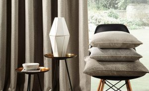 matching curtains and pile of cushions