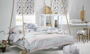 floating swing bed with matching roman blinds