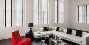 white blinds with black tape on sides