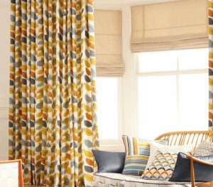 natural roman blinds and floral curtains