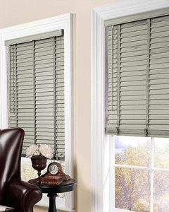 grey wooden blinds in lounge