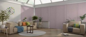 pink vertical blinds in a conservatory