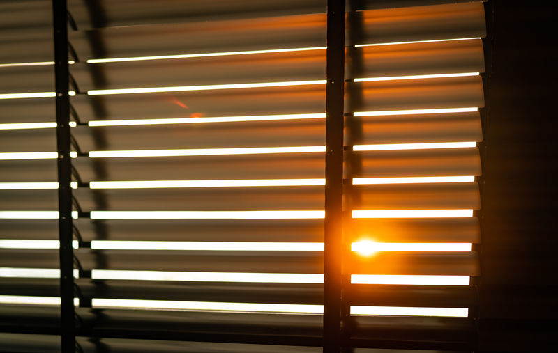 Venetian blinds with sunlight coming through window
