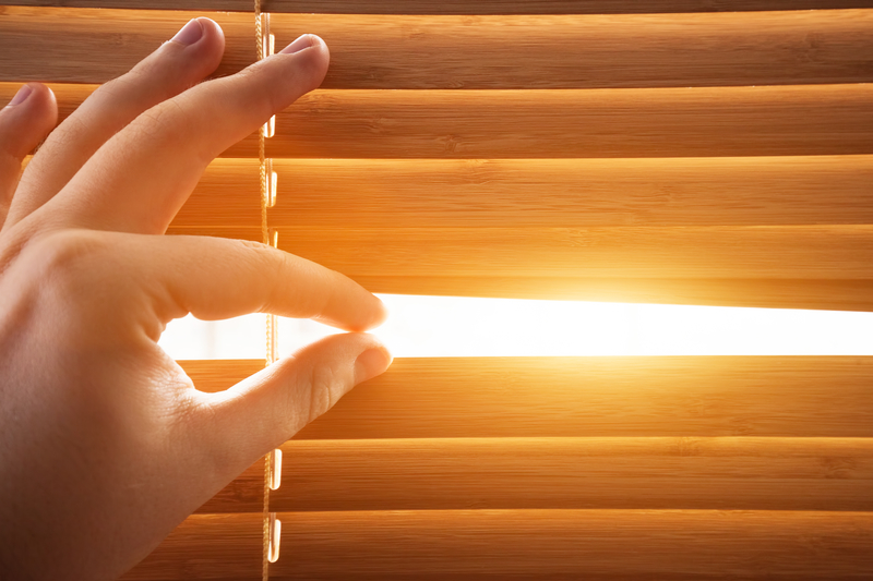 Sun through wooden blinds