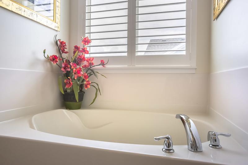 white bathroom and bath tub